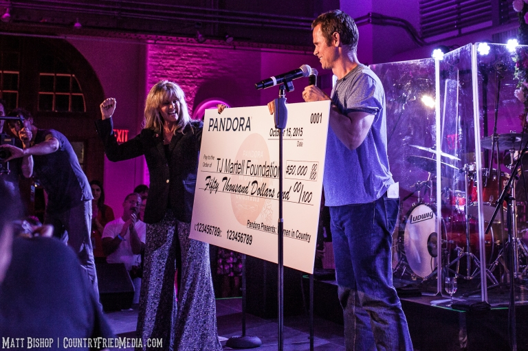 Pandora founder Tim Westergren presents a donation to The TJ Martell Foundation.